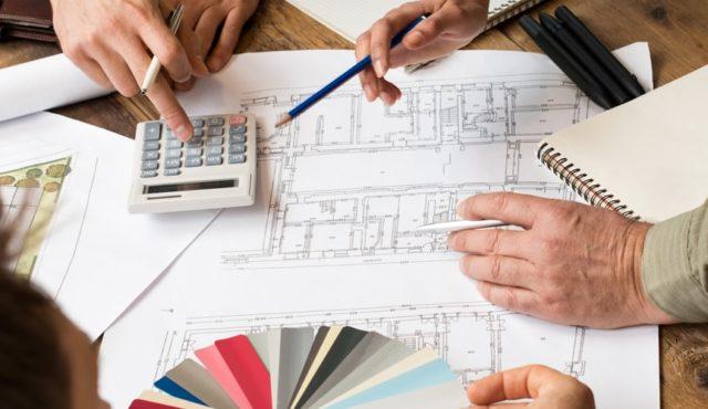 design team working on custom wine cellar plans